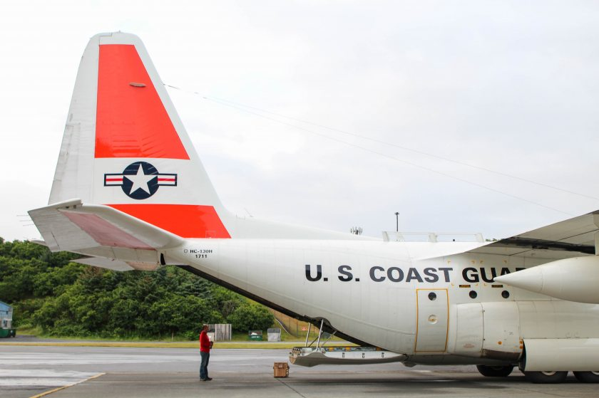 PSC Scientist Ignatius Rigor Monitoring the loading of a buoy into a Coast Guard C-130 in Kodiak, Alaska