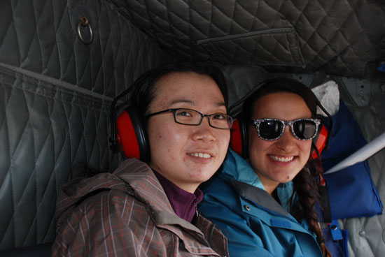 Graduate student Lu Liu and undergraduate student Laura Quante enjoying helicopter ride onto the ice sheet